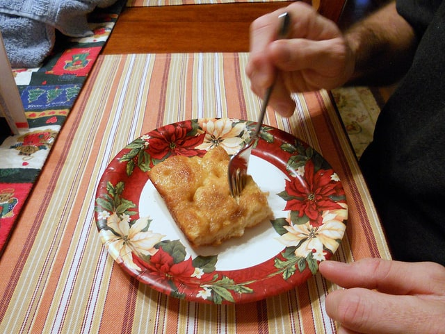 a slice of Moravian sugar cake on a paper plate