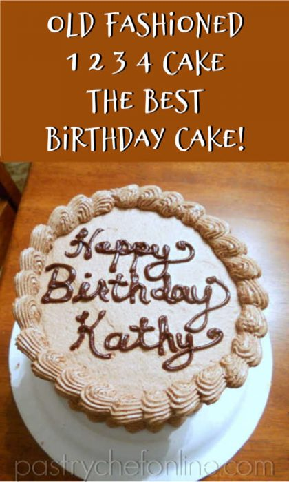 overhead shot of chocolate cake with writing on it reading Happy Birthday Kathy