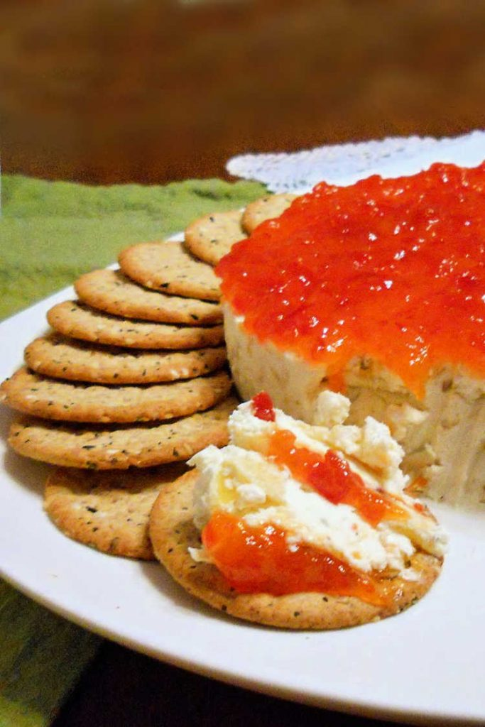 goat cheese cheesecake with pickled peppers and pepper jelly