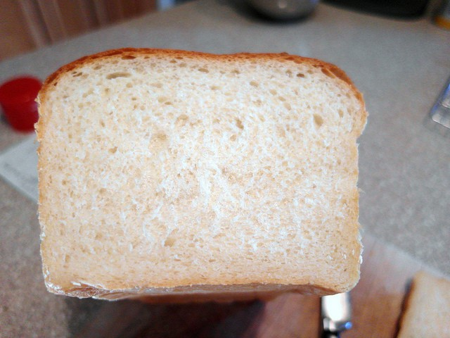 a cross section of a loaf of soft white bread