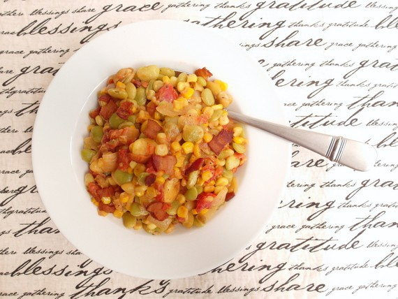 overhead shot of a shite plate of succotash on a graphic placemat