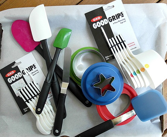 OXO gadgets including 3 spatulas, a small offset spatula, measuring spoons, cookie cutters, and measuring cups