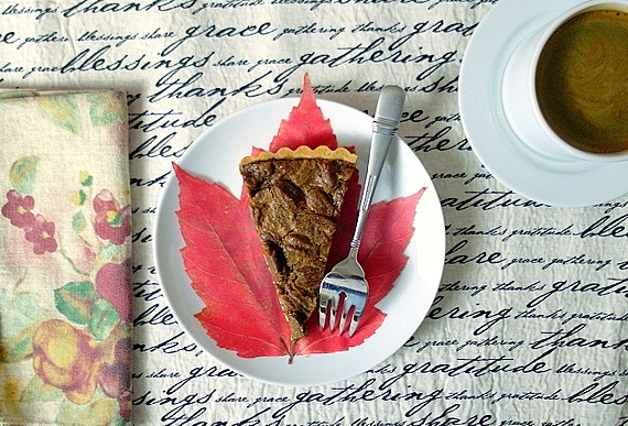 slice of coffee pecan tart with a cup of coffee