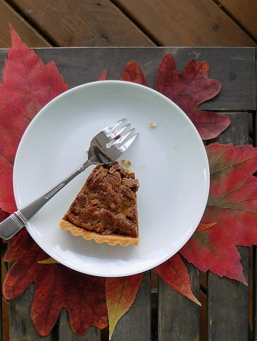a slice of coffee pecan tart on a plate