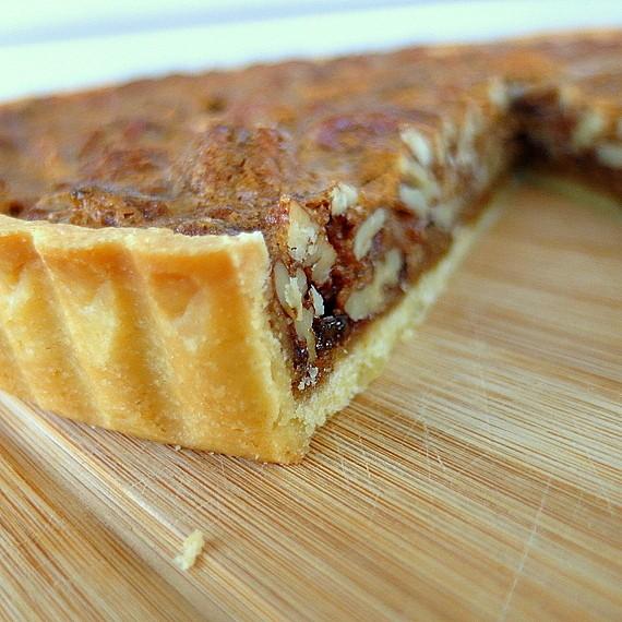 golden brown crust on a slice of coffee pecan tart