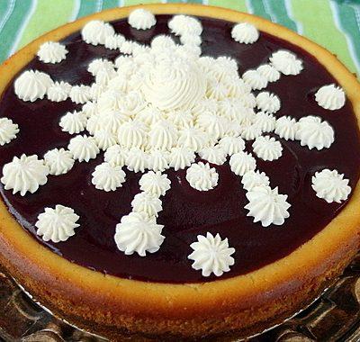 Orange Ricotta Mascarpone Cheesecake with Cranberry Puree and Whipped Mascarpone Cream