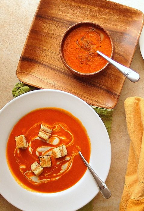 overhead shot of cajun spicy tomato soup in two different bowls