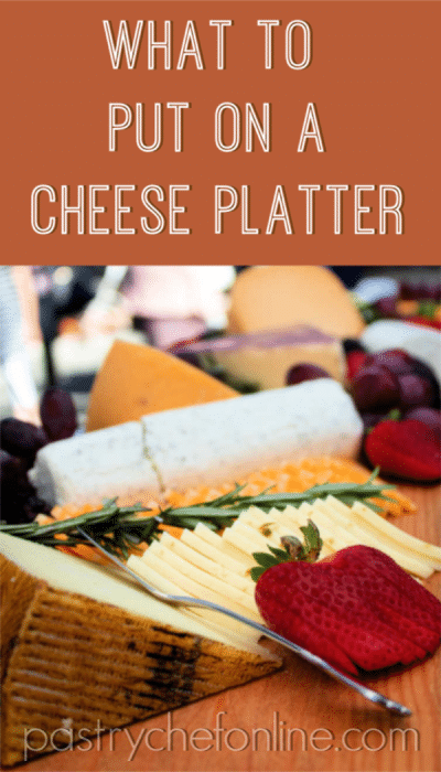 cheese and fruit on a board. text reads what to put on a cheese platter