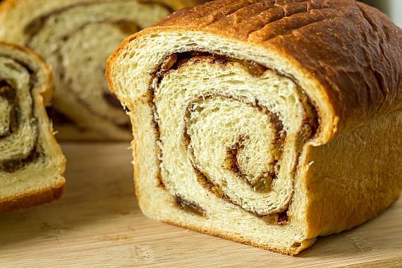 a sliced loaf of cinnamon raisin swirl bread