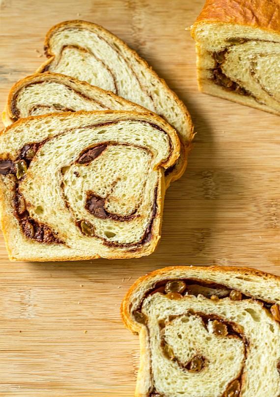 overhead view of slices of cinnamon swirl bread with raisins