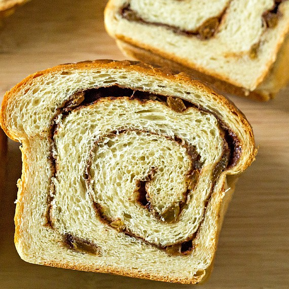 close up of a slice of cinnamon swirl bread showing a bit of a gap between two of the layers