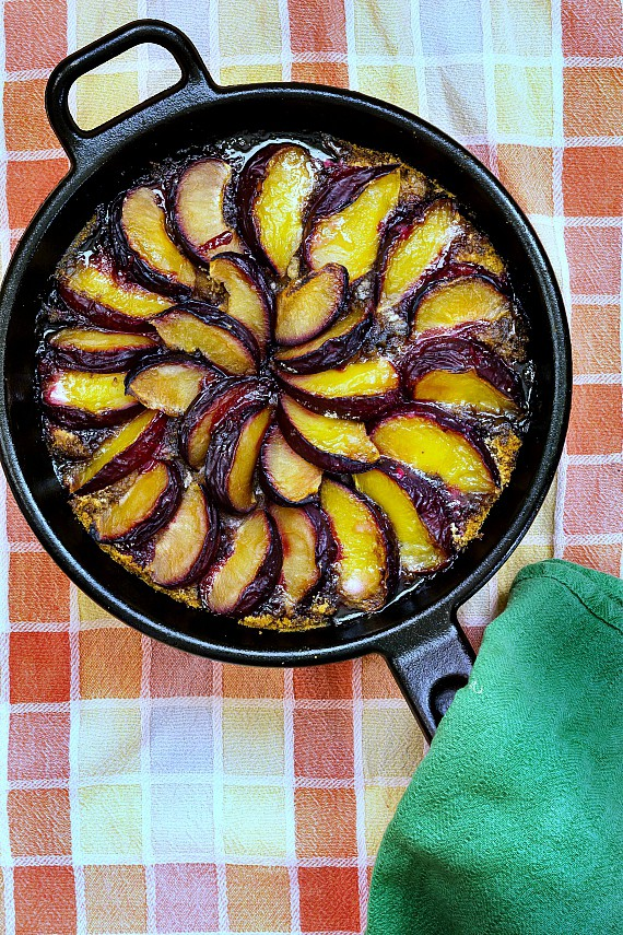 This German plum cake or plum kuchen is an easy to make, nostalgic treat. An enriched biscuit dough topped with cake or cookie crumbs, plums or peaches, and brown sugar. A delicious fruity coffee cake, it keeps well and reheats like a dream.