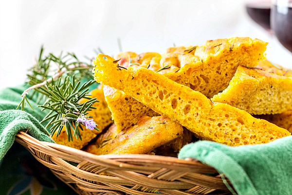 Roasted Pumpkin Herb Focaccia for Progressive Eats gets a flavor boost from a simple starter made the day before and fall flavors from both the pumpkin and poultry seasoning. And a little fresh rosemary never hurt anything! | pastrychefonline.com