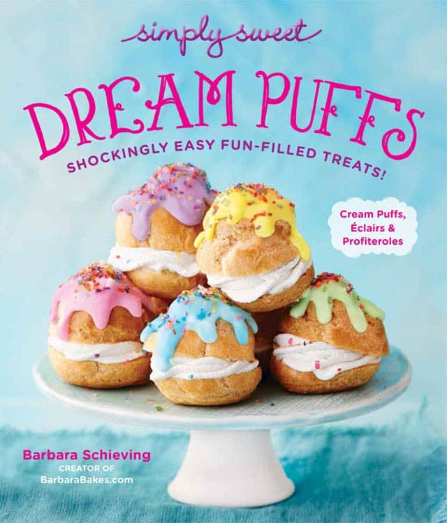 the cover image of simply sweet dream puffs showing a cake stand piled with profiteroles