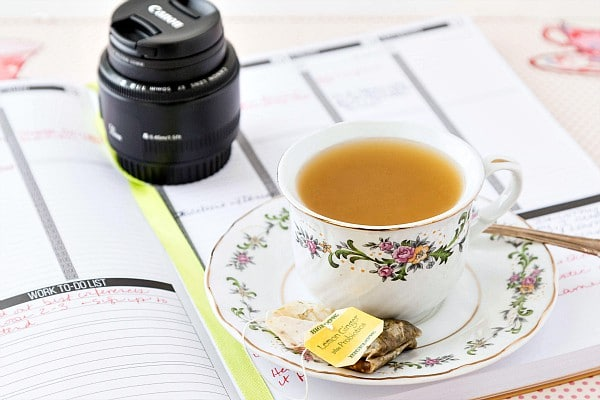 a cup of sore throat tea in a white teacup