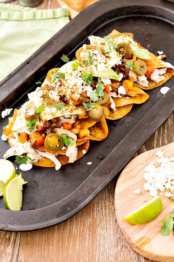 a platter of chicken and chorizo enchiladas