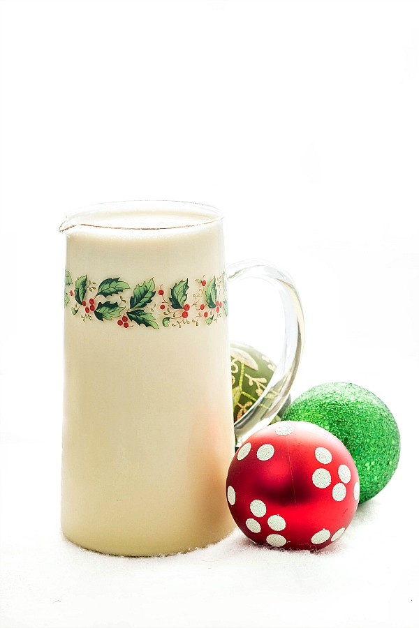 pitcher of eggnog with christmas ornaments