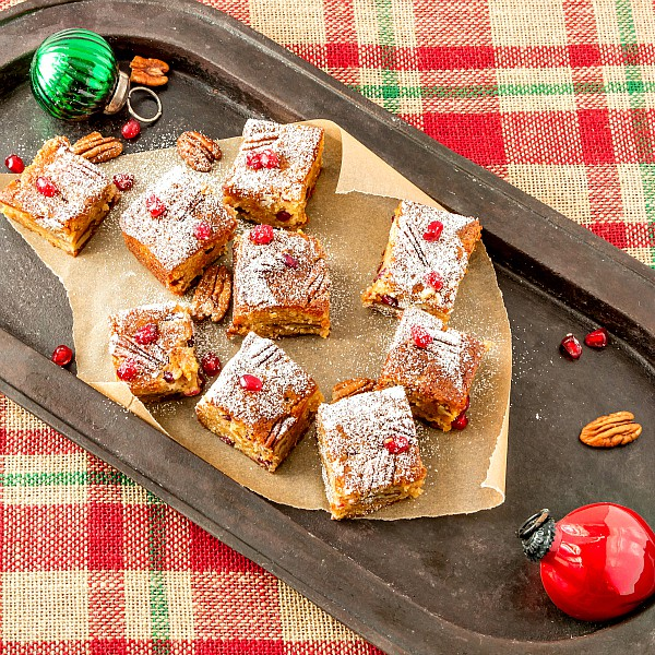 overhead shot of blondies with pecans and pomegranate arils