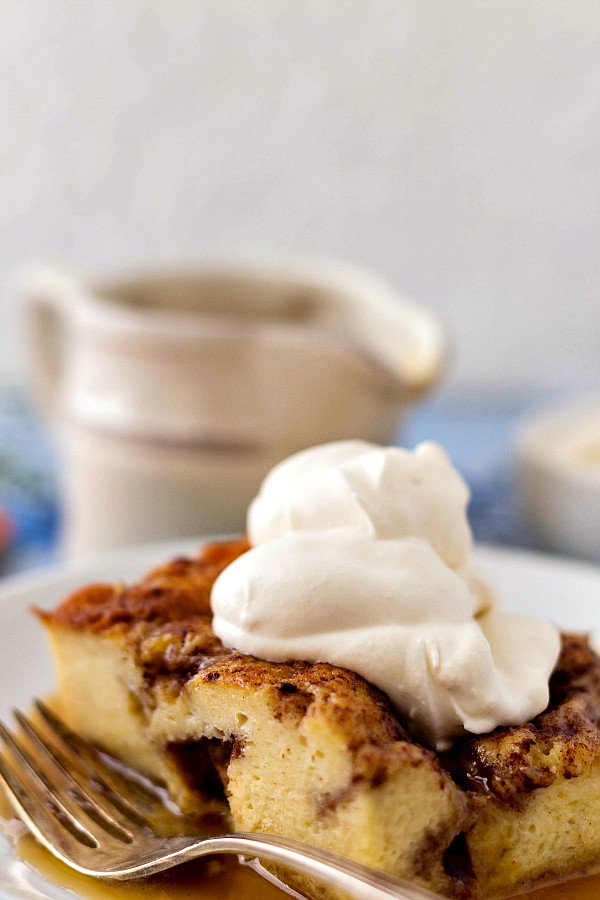 a slice of baked French toast made with leftover Moravian sugar cake with whipped cream on top