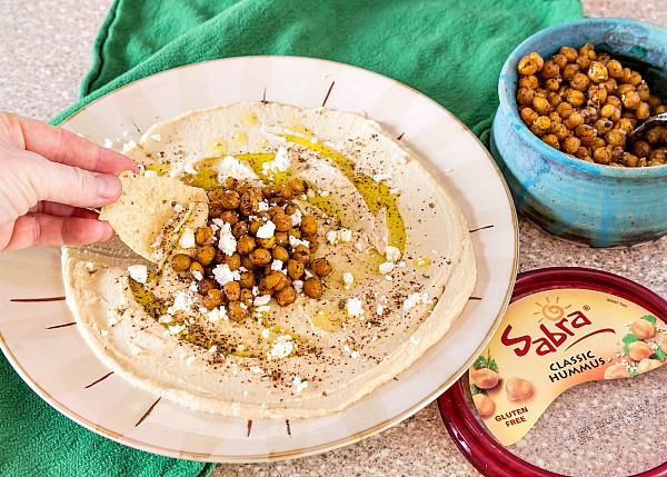 Celebrate the Unofficial Meal with these two easy delicious hummus toppings: spiced roasted chickpeas and chopped Greek salad. Both recipes are on the blog along with a video showing how to make each. Thank you, Sabra, for sponsoring this post. | pastrychefonline.com