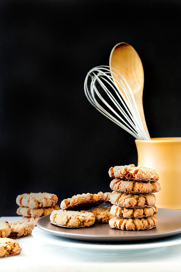 I present unto you the best black bottom triple peanut butter cookies in the world! How does this peanut butter cookie recipe end up with so much peanutty flavor? Natural peanut butter, peanut powder and chopped peanut brittle. These are seriously peanutty, just a touch chocolatey, and seriously delicious! | pastrychefonline.com