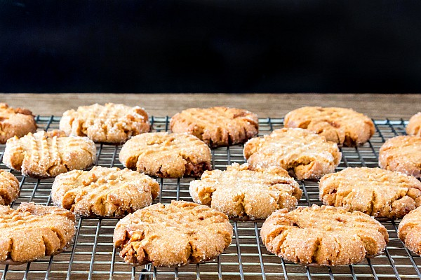 I present unto you the best black bottom triple peanut peanut butter cookies in the world! How does this peanut butter cookie recipe end up with so much peanutty flavor? Natural peanut butter, peanut powder and chopped peanut brittle. These are seriously peanutty, just a touch chocolatey, and seriously delicious! | pastrychefonline.com