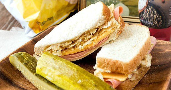 bologna and cheese sandwich with pickle spears