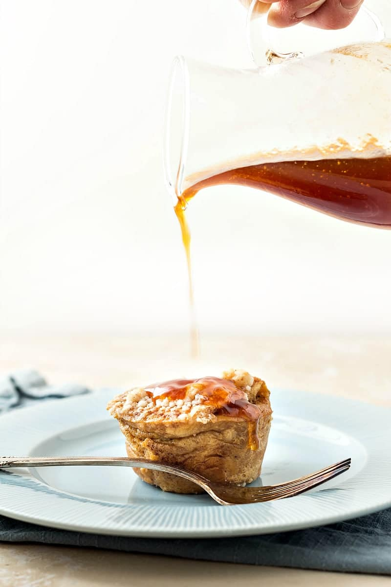 These Hawaiian Roll French Toast Muffins (or Individual Bread Puddings) are topped with buttery, crunchy streusel and get drenched in apple pie spiced apple cider syrup before serving. A decadent brunch treat or a delicious dessert you don't have to share! | pastrychefonline.com