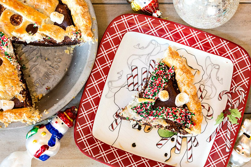 Mexican hot chocolate pie is rich, decadent and a little bit spicy. The cute snowman crust applique makes it irresistible and the perfect winter pie! If you're making this for kids, feel free to leave out the spices for a kid-friendly hot chocolate pie! | pastrychefonline.com
