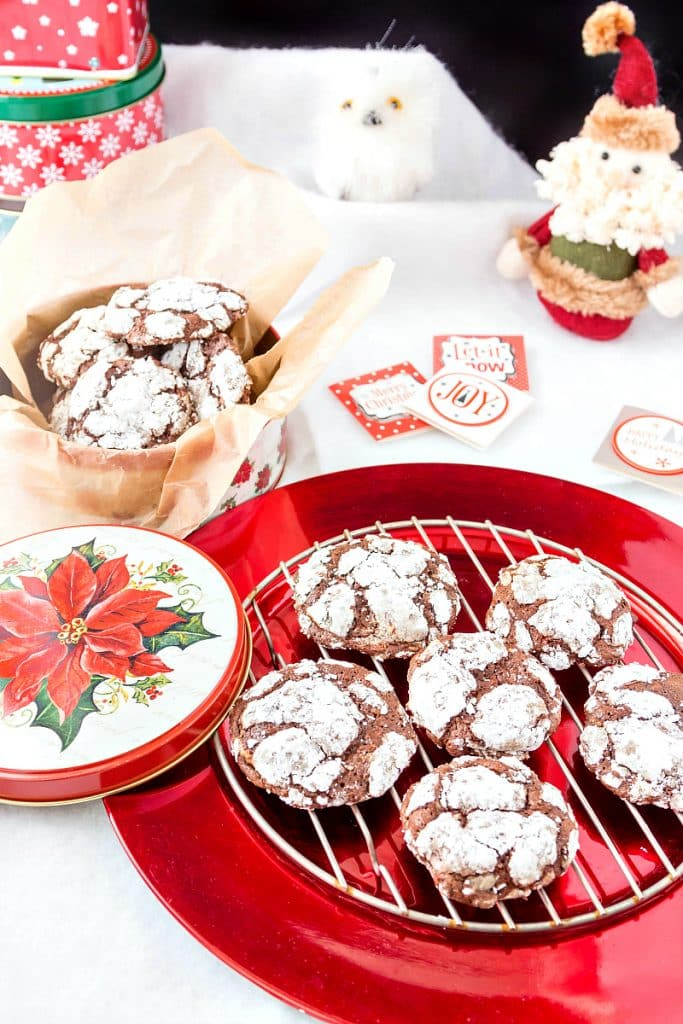 a round cooling rack of chcolate peppermint crinkle cookies on a red plate