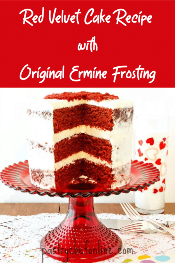 red velvet cake on a red cake stand with a large slice taken from it. Text reads Red Velvet Cake Recipe with Original Ermine Frosting