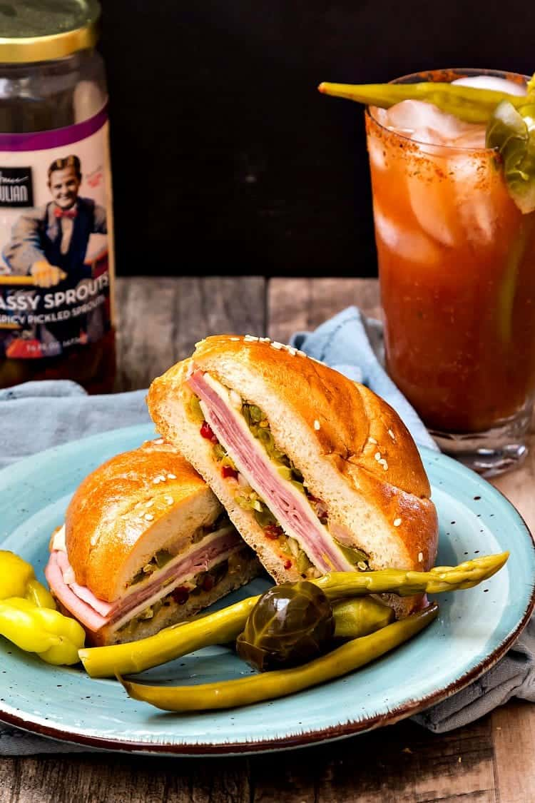 The North Carolina Muffaletta sandwich puts an NC spin on a NoLa classic with Bruce Julian Heritage Foods' Sassy Vegetables. Originally developed as Bloody Mary garnishes, they make a flavorful chopped pickled vegetable salad for the sandwich. #homegrownfare17 #sponsored | pastrychefonline.com