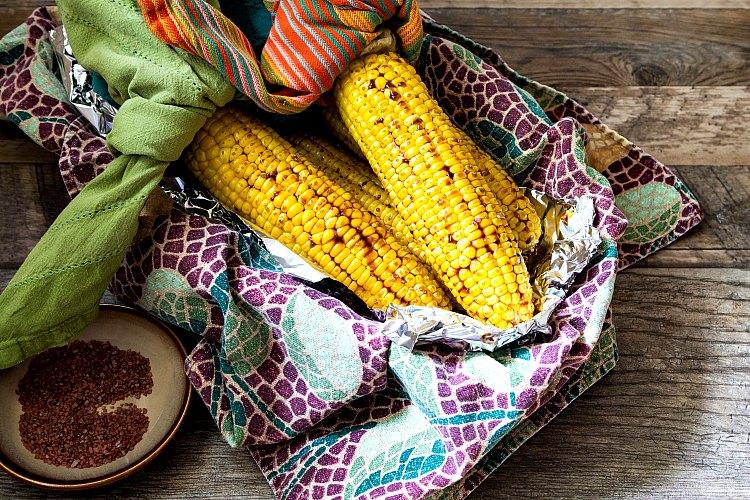 overhead shot of a cloth-lined basket of tea roasted corn
