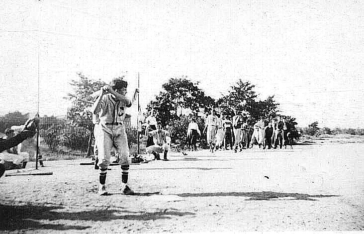 young man up at bat, mid-20th century Queens, NY