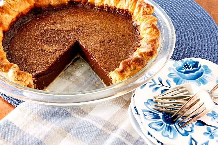 a chocolate pie with one slice cut out of it