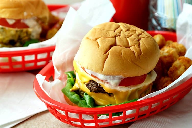 Calling all fans of the movie Grease, grab your best girl or guy and make this copycat Double Polar Burger with Everything, just like Danny Zuko ordered at Frosty Palace. This is an old-school burger recipe featuring simple ingredients and a ton of flavor. #progressiveeats | pastrychefonline.com