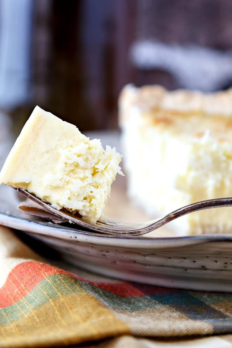 This traditional coconut custard pie uses minimal ingredients to make a pie that has a lovely textural contrast and is so homey and delicious you will think your pie-baking grandmother made it. #sponsored by Dover Publications, there is also a giveaway for a copy of The Epicurean by Charles Ranhofer. Drawing 12/1/2017. Good luck! | pastrychefonline.com