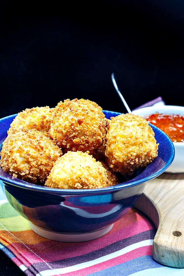 Pimento Cheese Stuffed Grits Arancini or fried grits balls are a fancy southern appetizer guaranteed to please at your next holiday cocktail party. Crispy on the outside, creamy and cheesy on the inside. When paired with pepper jelly for dipping, it's hard to beat these southern style arancini! | pastrychefonline.com