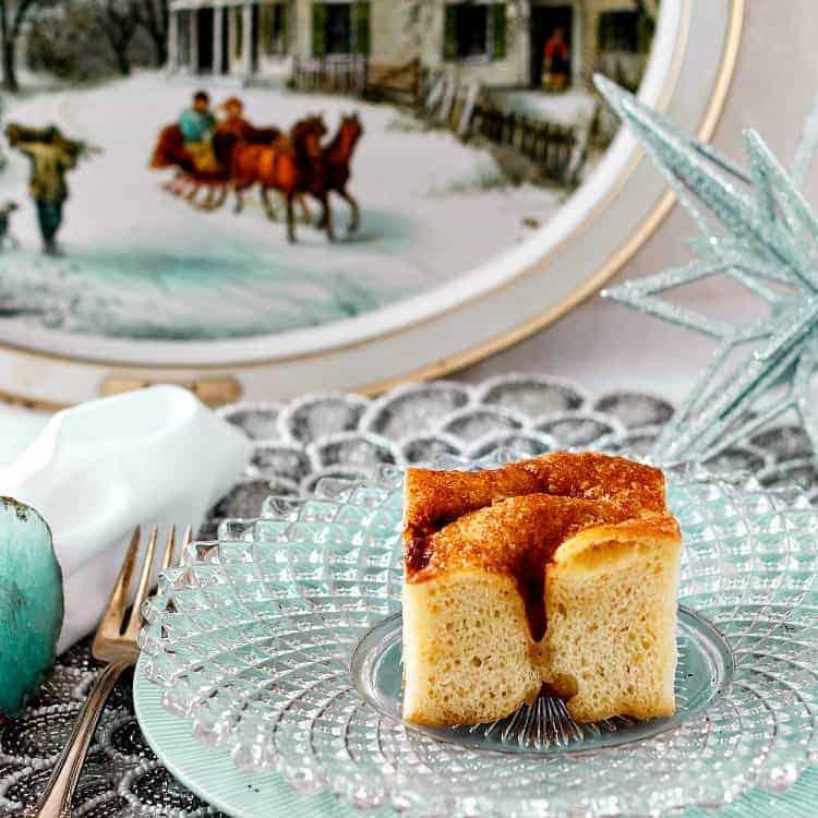 slice of moravian sugar cake on a glass plate