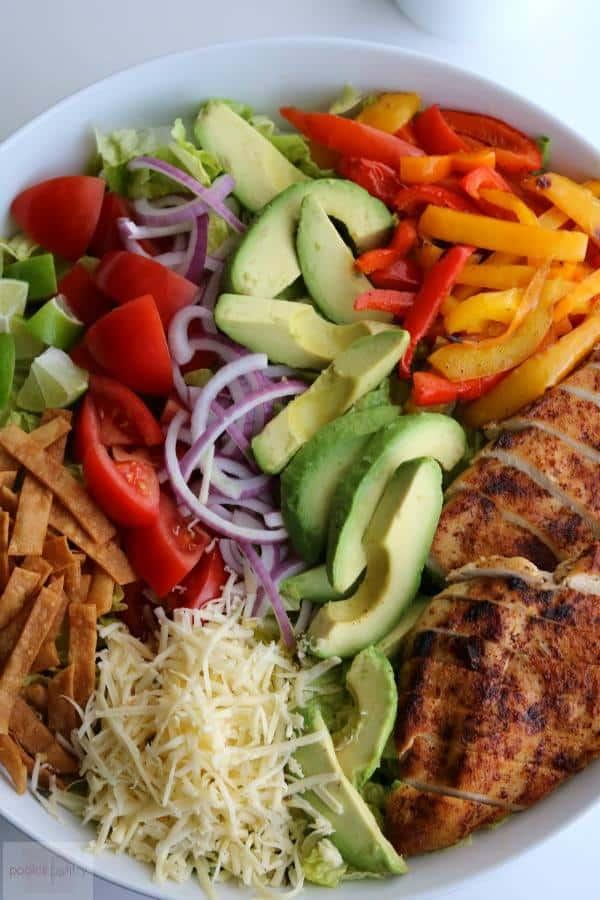 chicken taco salad with crispy tortilla strips and avocado buttermilk dressing