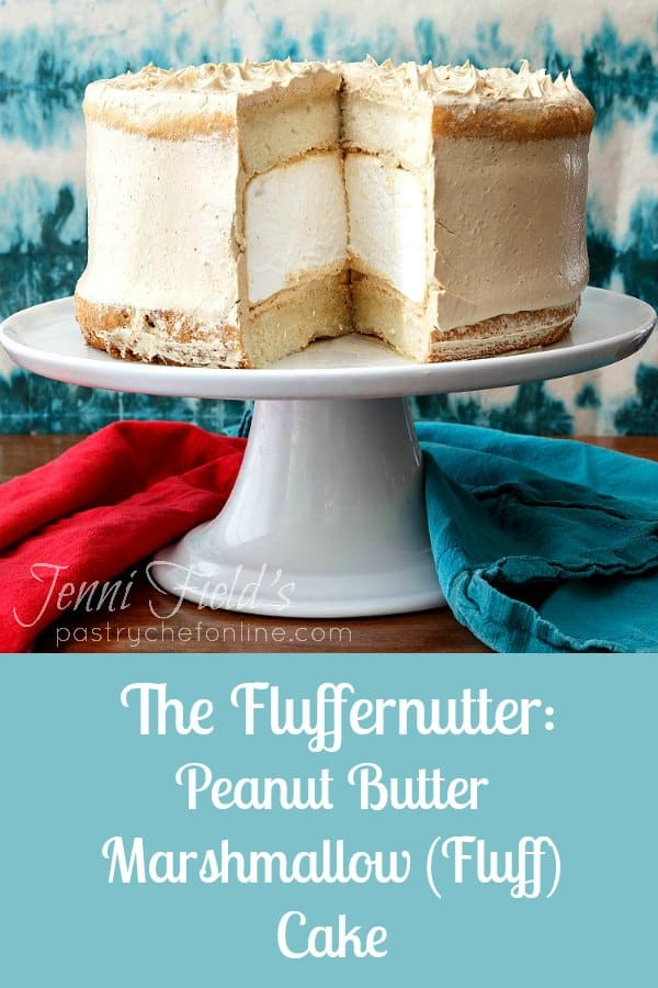 This peanut butter marshmallow cake is 2 layers of white cake sandwiching an impressive 2