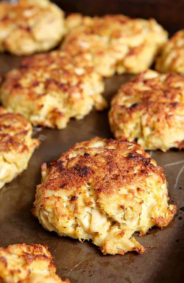 close up of a tray of broiled crab cakes