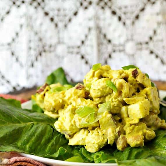 a scoop of curried chicken salad on a lettuce-lined plate