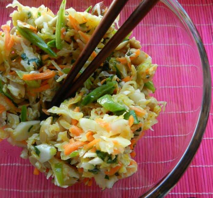 close up of a bowl of chopped Thai chicken salad with chopsticks