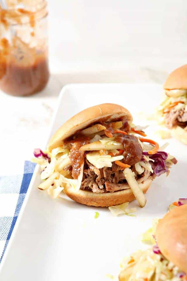 platter with pulled pork and slaw on buns