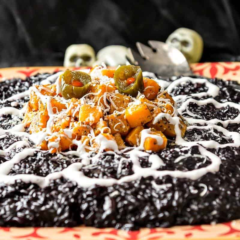 black rice risotto with diced butternut squash piled on top