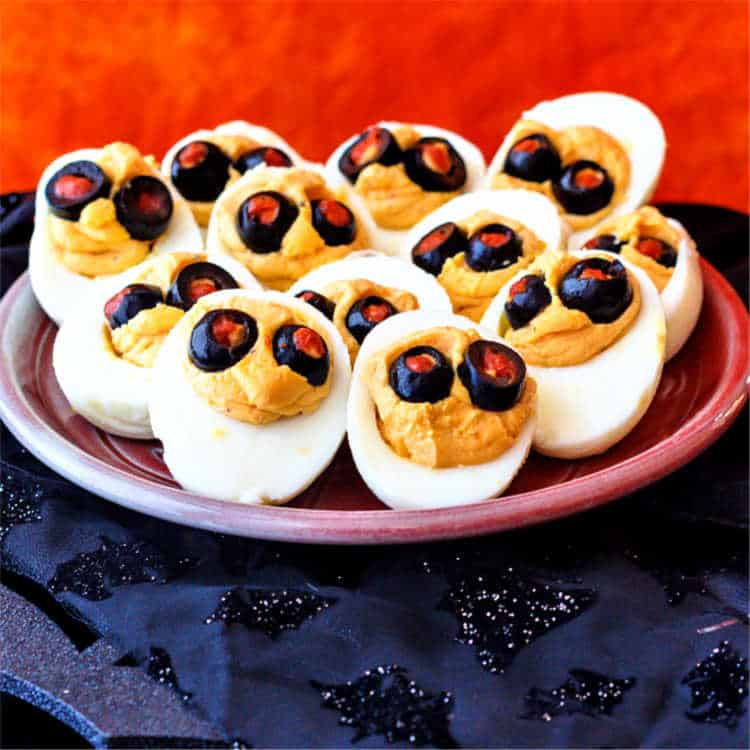 halloween deviled eggs on a small plate