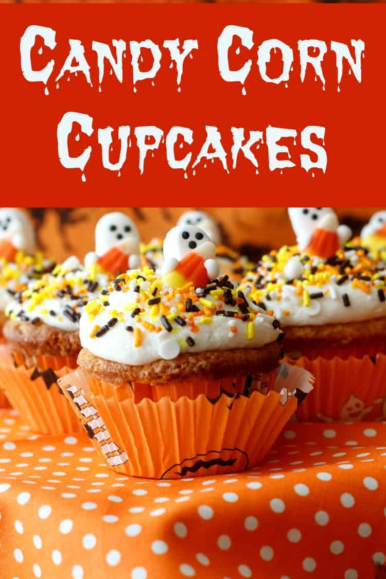 These candy corn cupcakes are moist and tender, and of course they're orange, yellow, and white inside and out! Perfectly spooky-cute for kids, adults will love these too. It's hard to beat the fluffy ermine frosting and crunchy little decorations. These are the cutest Halloween cupcakes! #halloween #cupcakes #cupcakerecipes | pastrychefonline.com