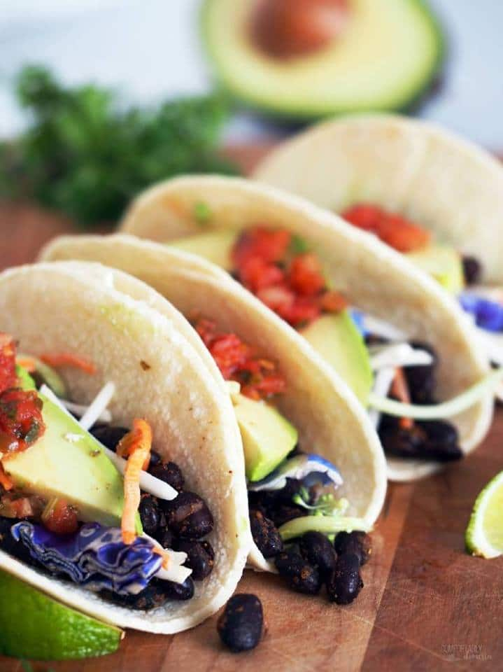 3 roasted black bean tacos with avocado, cabbage, and salsa