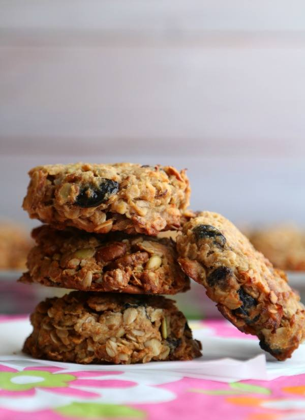 stack of 3 granola breakfast cookies with another leaning against the stack.